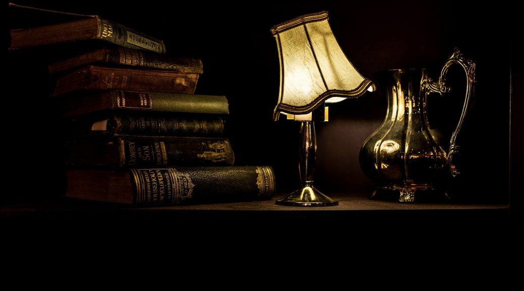 Stack of books with lamp
